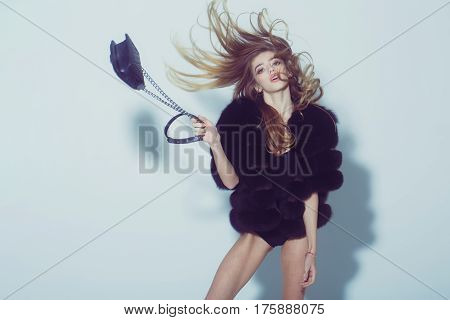 Pretty Sexy Woman With Long Hair In Fur With Bag