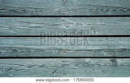 Weathered blue painted wooden fence texture with nail heads