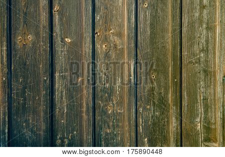 Dark green painted weathered wooden fence texture