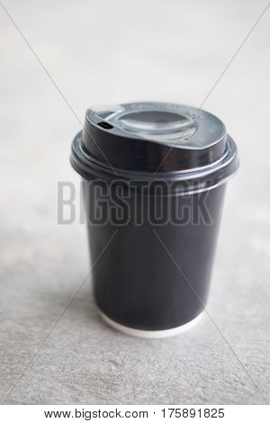 Disposable black plastic Cup with a lid. Cup for coffee