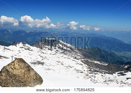 capped high mountain peaks and blue sky