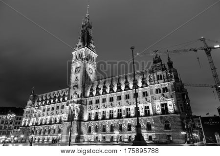 HAMBURG GERMANY - MARCH 9 2017: City Hall in Downtown at night in black and white.