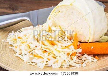 Shredded cabbage for cooking on wooden background. Studio Photo