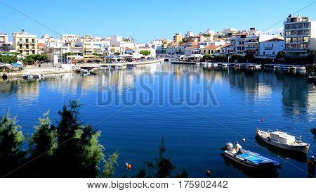 The Agios Nikolaos Marina, otherwise known as the Bottomless Lake, in the heart of Ag Nik on the island of Crete.