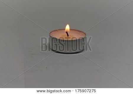white Tea light isolated on white background