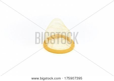 Condom on white background isolated macro picture
