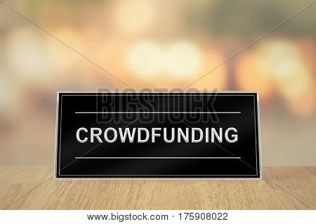 crowdfunding sign on wood table with blur background