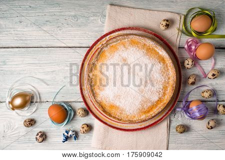 German Easter cake on a ceramic dish and eggs horizontal
