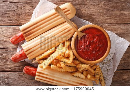 Fast Food: French Hot Dog Rolls With French Fries And Ketchup Closeup. Horizontal Top View