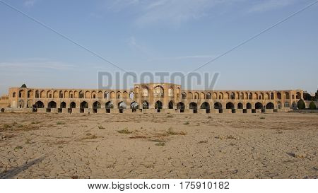 ISFAHAN, IRAN - OCTOBER 11, 2016: Khaju bridge crossing parched Zayandehrud river on October 11, 2016 in Isfahan, Iran