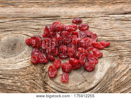 Red dried goji berries on wooden background