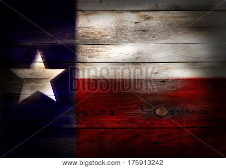 Flag of Texas USA painted on grungy wood plank background