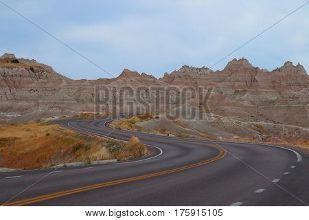 A lonely road going through Badlands National Park