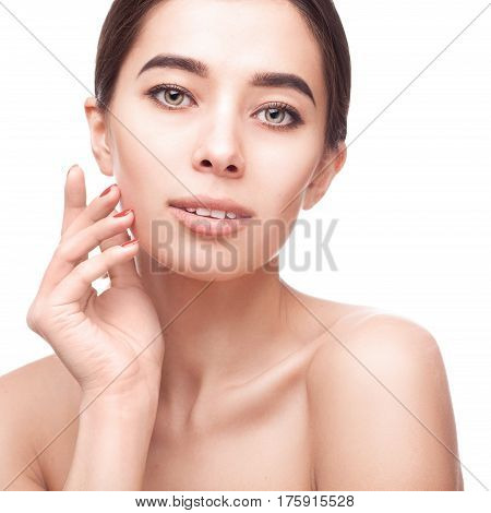 Beautiful face of young woman with clean fresh skin isolated on white background