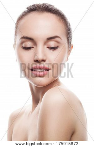 closeup portrait of young woman with clean fresh skin isolated on white studio background