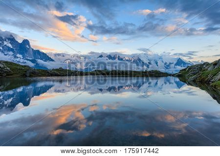 Mountains and sky reflected in Lac De Cheserys Chamonix France.