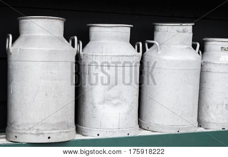 Metal Milk Churns Stand In Row