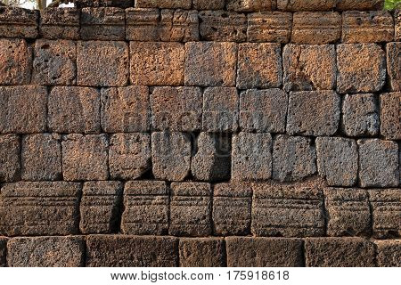 old historical laterite wall background of stone texture