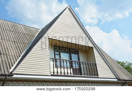 Gable and Valley type of roof construction. Building attic house construction with different types of roof designs and balcony.