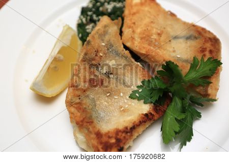 Pieces of breaded pikeperch on a plate
