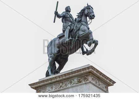 Madrid Spain - february 26 2017: Equestrian statue of Philip IV on the Plaza de Oriente. Isolated over white background. Made by Pietro Tacca