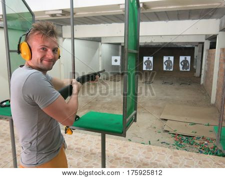 Man with a shotgun in a shooting range