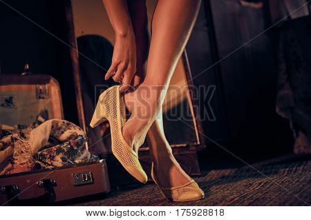 Young beautiful woman dressing the retro yellow shoes