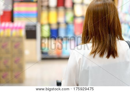 Woman shopping and looking for something to buy in super market