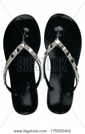 Pair of black beach sandals in rhinestones isolated on white background. View from above