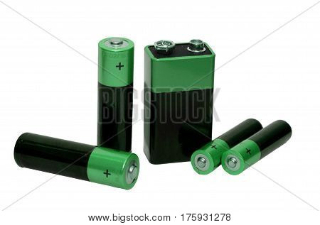 Many Different batteries green color, type AAA, type AA, type PP3, white background, isolated