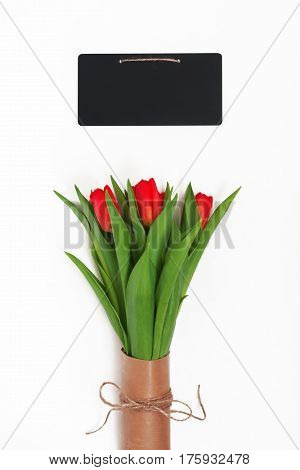 Bouquet Of Red Tulips Packed In Kraft Paper In Retro Style And Chalky Writing Board Isolated On Whit