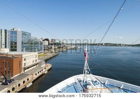 The cruise ship is docking in Halifax city (Nova Scotia).