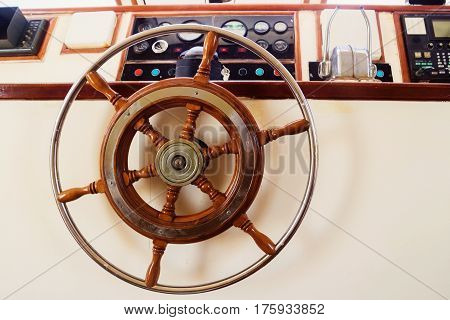 Captain's cabin and steering wheel close-up on a yacht.