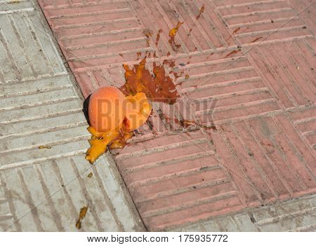 Fruit Smash. Smashed apricot on the pavement.