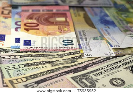 Money Background American Dollars, Euro And Swiss Franc.