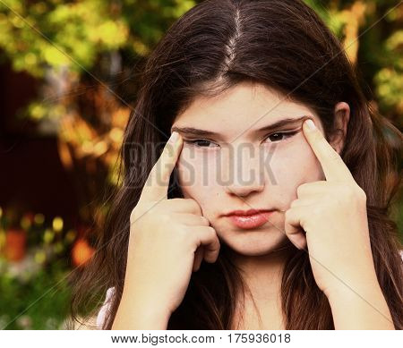 teen girl  with myopia try to see something far away