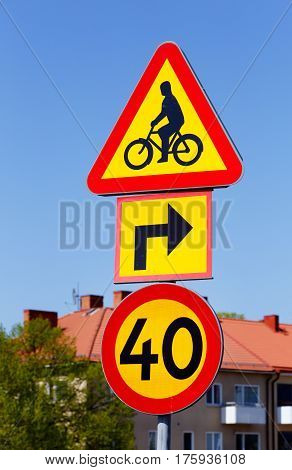 Swedish road signs for bicycle crossing warning sign and speed limit 40.