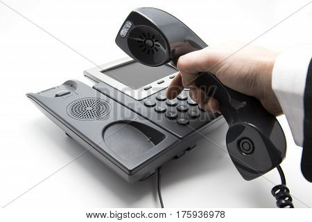 Making a call Businessmann is dialing IP telephone keypad