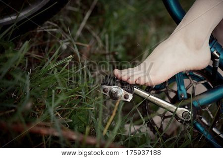 Leg of young girl on pedal bike closeup