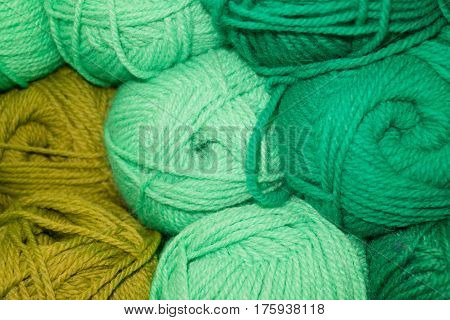 Many woolen yarn green light green and mustard color rich texture