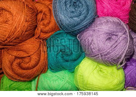Many woolen yarn variegated colors, rainbow background