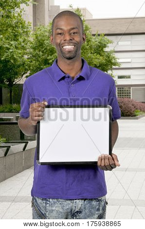 Young man holding up a blank sign