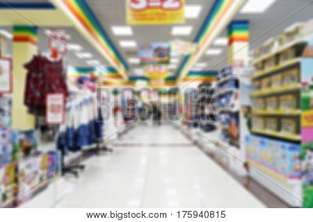 Abstract blurred and defocused image of supermarket or shopping mall for background backdrop or backcloth.
