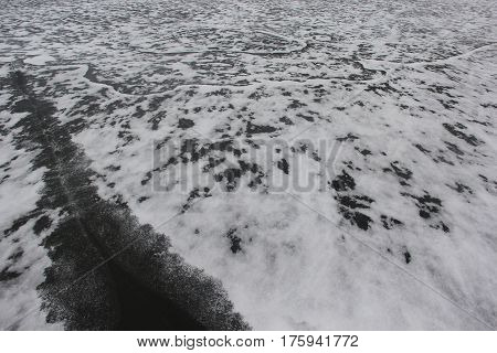 Wind blown snow on a frozen lake in Michigan