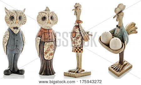 Wooden figurines, wooden statuette of an owl and wooden statuette of a chicken, isolated white background