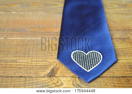 Fathers Day tie: Blue tie on wooden background