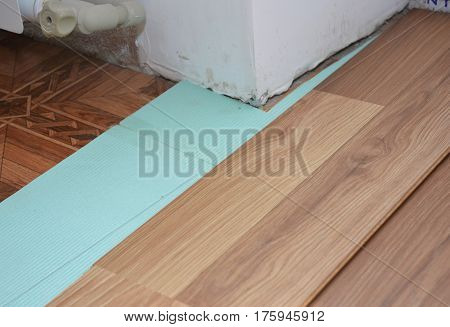 Home improvement - installing laminate flooring in problem area.