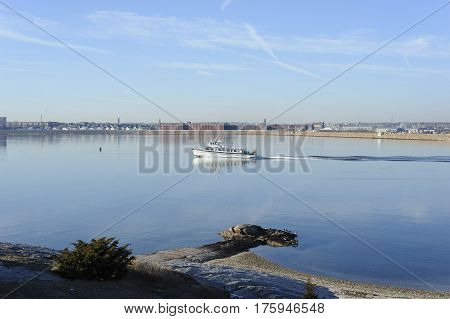 Fairhaven Massachusetts USA - January 16 2017: Ferry to Cuttyhunk Island picks up speed on the Acushnet River as it leaves New Bedford