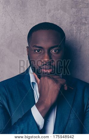 Portrait Of Handsome Afroamerican Man In Stylish Suit Holding Hands In Chin And Think