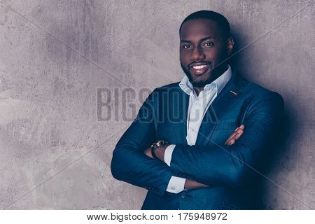 Portrait Of Successful  Handsome Afroamerican Man In Stylish Suit Crossed Hands And Smiling